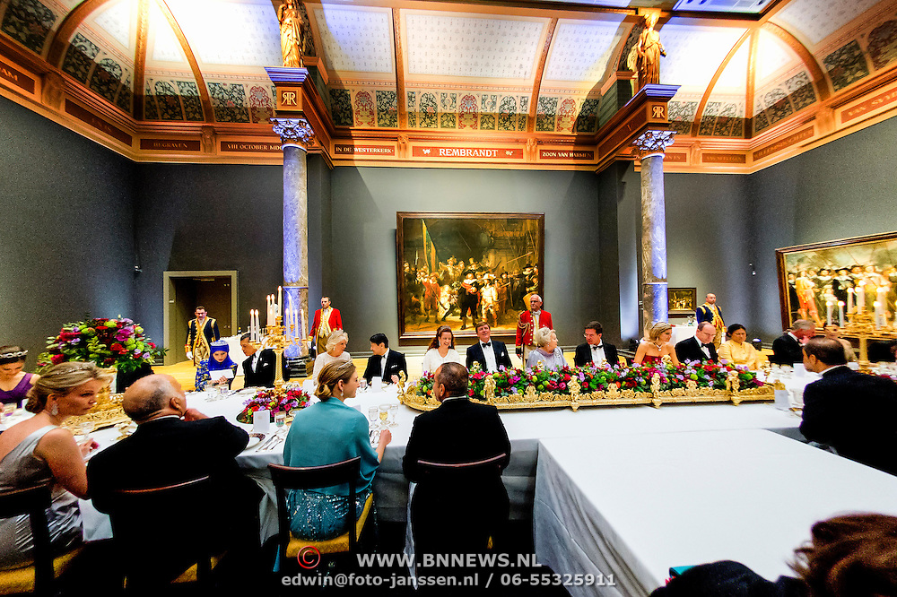 Queen Beatrix is having dinner with members of the royal family and guests in front of Rembrandt's The Night Watch painting, at the Rijksmuseum in Amsterdam, The Netherlands, on Monday night, April 29, 2013. HANDOUT/ROBIN UTRECHT