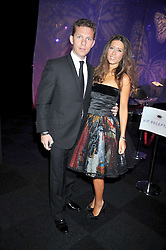 NICK CANDY and YAEL TORM-HIBLER at The Butterfly Ball in aid of the Caudwell Children Charity held in Battersea park, London on 14th May 2009.