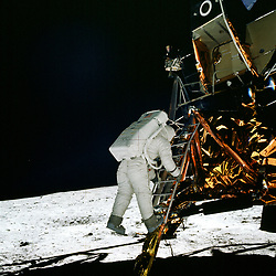 The Moon - (FILE) -- Apollo 11 Lunar Module pilot Edwin Aldrin climbs down the ladder to the Moon's surface as Commander Neil Armstrong photographs his descent. Aldrin stepped onto the surface on Sunday, July 20, 1969, 11:15 EDT and became the second person to walk on the Moon. Photo by CNP/ABACAPRESS.COM