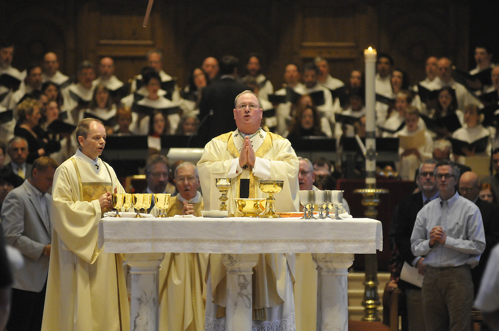 Archbishop Dolan celebrates the Eucharist during Easter mass, Sunday April 12 2009.  This is his last mass as Archbishop of Milwaukee.