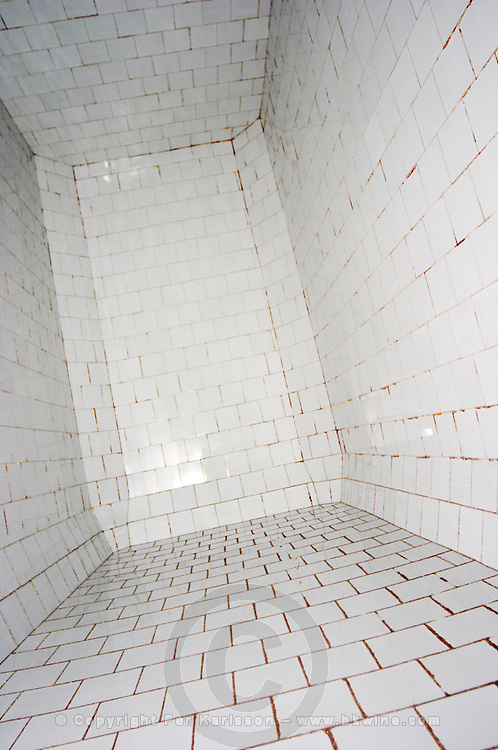 In the winery: The inside interior of a concrete fermentation vat. It is lined with white tiles., the Union Champagne cooperative, also called Champagne de Saint Gall in Avize, Cote des Blancs, Champagne, Marne, Ardennes, France