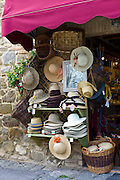 Hats and souvenirs in shop in Montalcino, Val D'Orcia,Tuscany, Italy