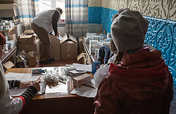 Victoria, 9, collects her medicine from the MSF mobile clinic pharmacy after her consultation with a doctor in the village of Gorodishe, near Lugansk.