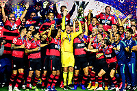 SAO PAULO, BRAZIL - FEBRUARY 25: Goalkeeper Diego Alves and Diego of CR Flamengo lift the champions trophy and celebrates with his team mates ,after a Brasileirao Serie A 2020 match between Sao Paulo FC and CR Flamengo at Morumbi Stadium on February 25, 2021 in Sao Paulo, Brazil. <br />  (Photo by MB Media/BPA)