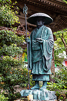 """Kukai, also known posthumously as Kobo Daishi was a Japanese monk, scholar, poet, and artist, founder of the Shingon or """"True Word"""" school of Buddhism. The meaning of the name Kobo Daishi recognizes his excellence as a teacher as well as his work to spread Esoteric Buddhism throughout Japan. Many temples along the Shikoku Pilgrimage trail have large statues of Kobo Daishi on their grounds.  This one is at Iwamoto-ji Temple No. 37."""