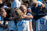 Clifton players & supporters after their match against Reading at the Investec Women's Hockey League Finals Weekend, Sonning Lane, Reading, UK on 13 April 2014. Photo: Simon Parker