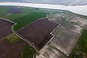 Nederland, Friesland, gemeente Wonseradeel, 28-04-2010; Polder de Weeren, ten noorden van Makkum. Makkumer noordwaard (Makkumerwaard ) in de achtergrond..luchtfoto (toeslag), aerial photo (additional fee required).foto/photo Siebe Swart