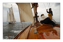 Trimming on Solway Maid, a 53' Burmudan Cutter the last of the boast to be built at the Fife yard. Here racing on the sunday's race to Helensburgh to windward of Kentra...This the largest gathering of classic yachts designed by William Fife returned to their birth place on the Clyde to participate in the 2nd Fife Regatta. 22 Yachts from around the world participated in the event which honoured the skills of Yacht Designer Wm Fife, and his yard in Fairlie, Scotland...FAO Picture Desk..Marc Turner / PFM Pictures