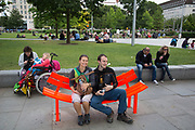Couple sitting on one of the flourescent benches on the Southbank, London, United Kingdom. The South Bank is a significant arts and entertainment district, and home to an endless list of activities for Londoners, visitors and tourists alike. (photo by Mike Kemp/In Pictures via Getty Images)