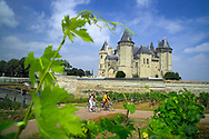 Tours, Loire, France, July 2006. The city of Saumur is dominated by the chateau and the bridge over the Loire. The best way to experience the Loire region is by bike. The 'Loire a Velo' trail leads through ancient villages with medieval castles, fields of wheat and sunflowers, vineyards and wine producers in the region. Photo by Frits Meyst/Adventure4ever.com