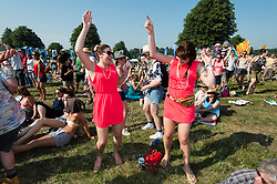 © Licensed to London News Pictures. 18/07/2014. Southwold, UK.   Festival goers dance in the hot sun as Kelis performs on the main stage of Latitude Festival 2014 Day 1 Friday.    Festival goers dance as Kelis performs on the main stage of Latitude Festival 2014 Day 1 Friday.  Latitude is a British annual music festival.  Photo credit : Richard Isaac/LNP