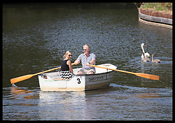 July 27, 2018 - Tonbridge, United Kingdom - Image licensed to i-Images Picture Agency. 27/07/2018. Tonbridge, Kent, United Kingdom. A couple with just a family of swans for company as they take a boat trip on the river Medway in Tonbridge,Kent, as the UK heatwave continues. (Credit Image: © Stephen Lock/i-Images via ZUMA Press)