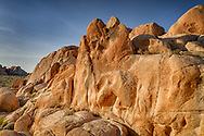 USA, California, Joshua Tree National Park. Sun rises over a rock formation.