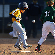 A runner makes second base during the Norwalk Little League baseball competition at Broad River Fields, Norwalk, Connecticut. USA. Photo Tim Clayton