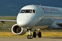 Air Canada Embraer 190 C-FHJT taxies in the setting sun at Whitehorse International Airport