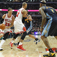 26 March 2012: Chicago Bulls shooting guard Kyle Korver (26) drives past Denver Nuggets shooting guard Arron Afflalo (6) on a screen set Chicago Bulls forward Taj Gibson (22) during the Denver Nuggets 108-91 victory over the Chicago Bulls at the United Center, Chicago, Illinois, USA. NOTE TO USER: User expressly acknowledges and agrees that, by downloading and or using this photograph, User is consenting to the terms and conditions of the Getty Images License Agreement. Mandatory Credit: 2012 NBAE (Photo by Chris Elise/NBAE via Getty Images)
