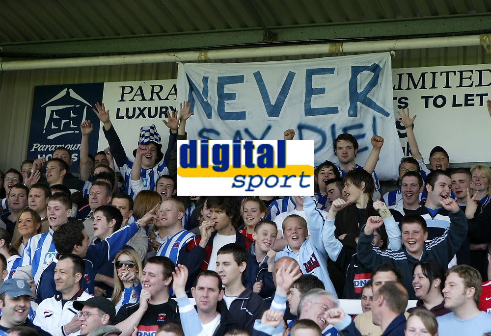 """Photo: Andrew Unwin.<br />Hartlepool United v Port Vale. Coca Cola League 1. 06/05/2006.<br />Hartlepool fans with a banner that reads, """"Never say die""""."""