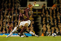 Photo: Leigh Quinnell.<br /> Arsenal v Fulham. The Barclays Premiership.<br /> 24/08/2005. Arsenals Gilberto is sent flying by Fulhams Luis Boa Morte.