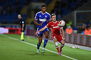 Craig Noone of Cardiff city holds off Tyrone Mings of Ipswich Town (l). Skybet football league championship match, Cardiff city v Ipswich Town at the Cardiff city stadium in Cardiff, South Wales on Tuesday 21st October 2014<br /> pic by Andrew Orchard, Andrew Orchard sports photography.