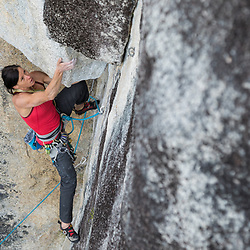Ines Papert leading Hungry Wolf, 5.11b at Gobsmack wall, Shannon Falls in Squamish, BC during the Arcteryx Photo Shootout.