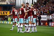 Michael Keane of Burnley (c) celebrates with his teammates after scoring his teams 1st goal.  Skybet football league championship match, Burnley  v Brentford at Turf Moor in Burnley, Lancs on Saturday 22nd August 2015.<br /> pic by Chris Stading, Andrew Orchard sports photography.
