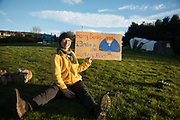 Banner and placard making in the protector camp ahead of the the day of protest against the mining company Banks outside Dipton in Pont Valley, 4 May 2018, County Durham, United Kingdom. Sunset in Pont Valley ahead of the the day of protest against the mining company Banks outside Dipton in Pont Valley, County Durham, 4 May 2018. Locals have fought the open cast coal mine for thirty years and three times the local council rejected planning permissions but central government has overruled that decision and the company Banks was granted the license and rights to extract coal in early 2018. Locals have teamed up with climate campaigners and together they try to prevent the mining from going ahead. The mining will have huge implications on the local environment and further coal extraction runs agains the Paris climate agreement. A rare species of crested newt is said to live on the land planned for mining and protectors are trying to stop the mine to save the newt.