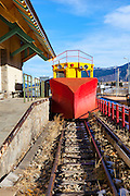 Snow plough or chasse beige on the Train Jaune, Yellow Train, Canari, or Ligne de Cerdagne, is a 63km long railway from Villefranche-de-Conflent to Latour-de-Carol, rising from 427m to 1,593m at Bolquère-Eyne, the highest railway station in France. In early 2015 the future of the line was uncertain, with SNCF and the French government considering either to close the line, or to privatise it for tourism use. Photography taken at Gare de Mont-Louis - La Cabanasse.