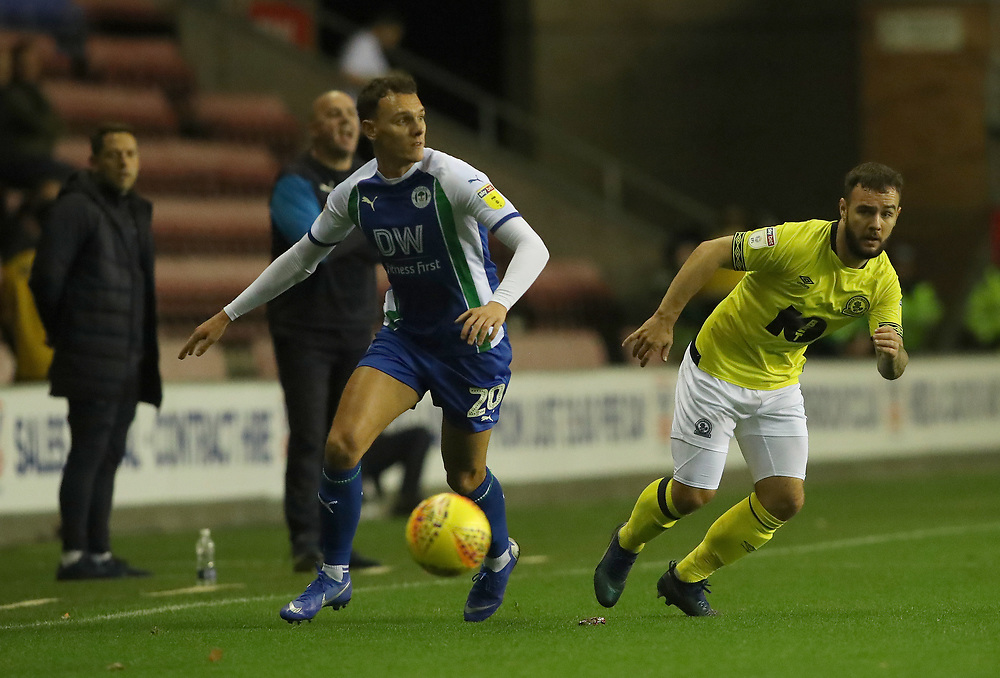 Wigan Athletic's Kal Naismith and Blackburn Rovers' Adam Armstrong<br /> <br /> Photographer Rachel Holborn/CameraSport<br /> <br /> The EFL Sky Bet Championship - Wigan Athletic v Blackburn Rovers - Wednesday 28th November 2018 - DW Stadium - Wigan<br /> <br /> World Copyright © 2018 CameraSport. All rights reserved. 43 Linden Ave. Countesthorpe. Leicester. England. LE8 5PG - Tel: +44 (0) 116 277 4147 - admin@camerasport.com - www.camerasport.com