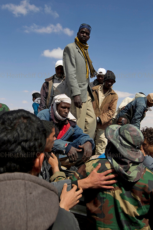 Mcc0030300 . Daily Telegraph..African migrant workers who were stopped at the West Gate of Ajdabiyah and questioned by rebels fighters before finally being released. Some rebels suggested they should be shot for suspicion of being mercenaries and spies...Ajdabiyah 30 March 2011