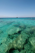 Amazing clear waters of Mitjorn, in the paradisiac island of Formentera. <br /> <br /> Formentera is the smallest and southernmost island of the Illes Pitiüses group (which includes Ibiza and Formentera) and belongs to the Balearic Islands autonomous community (Spain). It is 19 kilometres (12 mi) long and is located approximately 6 kilometres (4 mi) south of Ibiza in the Mediterranean Sea. Its major villages are Sant Francesc Xavier, Sant Ferran de ses Roques, El Pilar de la Mola and La Savina.