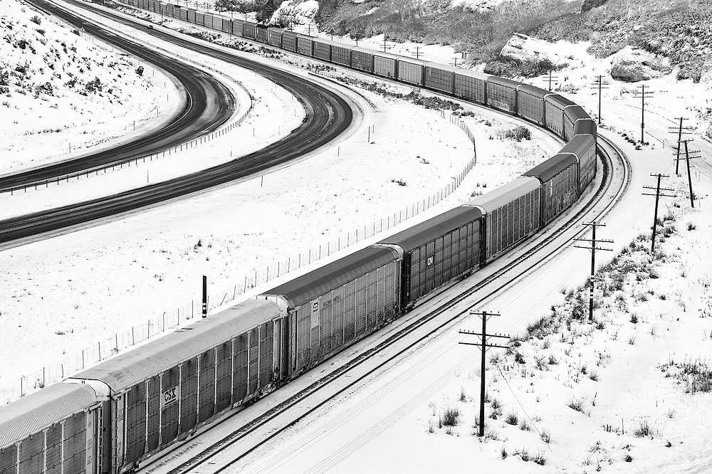 An eastbound train of empty autoracks eases down Weber Canyon.