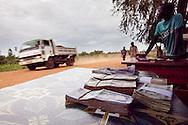 Money changers at the border crossing between Sudan and Uganda.