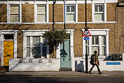 A women walking along Railton Road on the 25th February 2019 in Herne Hill in the United Kingdom. A new English record was set on this day with temperatures rising to 20.1C in south-west London. It is the first time a temperature of over 20C has been recorded in England during winter.