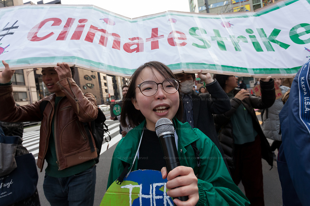 """Aina Koide, one of the organisers of the Global Strike for Future at the United Nations University, Shibuya, Tokyo, Japan.Friday March 15th 2019. Part of a global day of action in 98 countries and nearly 2,000 cities; this was Japan's second Fridays for Future event, known as """"School strikes"""", and took place from 2pm to 4pm with activists and students holding signs demanding leaders, internationally and nationally, take measures to reduce ecologically damaging activities. The movement was started in 2018 by Swedish schoolgirl, Greta Thunberg, who began striking from her lessons when she realised that adult leaders were doing nothing to ensure there would be the future she was studying for."""