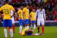 England Leicester City forward Jamie Vardy (9) looks at Brazil Paris Saint Germain PSG defender Dani Alves (2) who seems to be injured during the International Friendly match between England and Brazil at Wembley Stadium, London, England on 14 November 2017. Photo by Simon Davies.