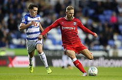 Gillingham's Scott Wagstaff (right) gets a shot on gaol past Reading's Liam Kelly during the Carabao Cup, first round match at the Madejski Stadium, Reading.