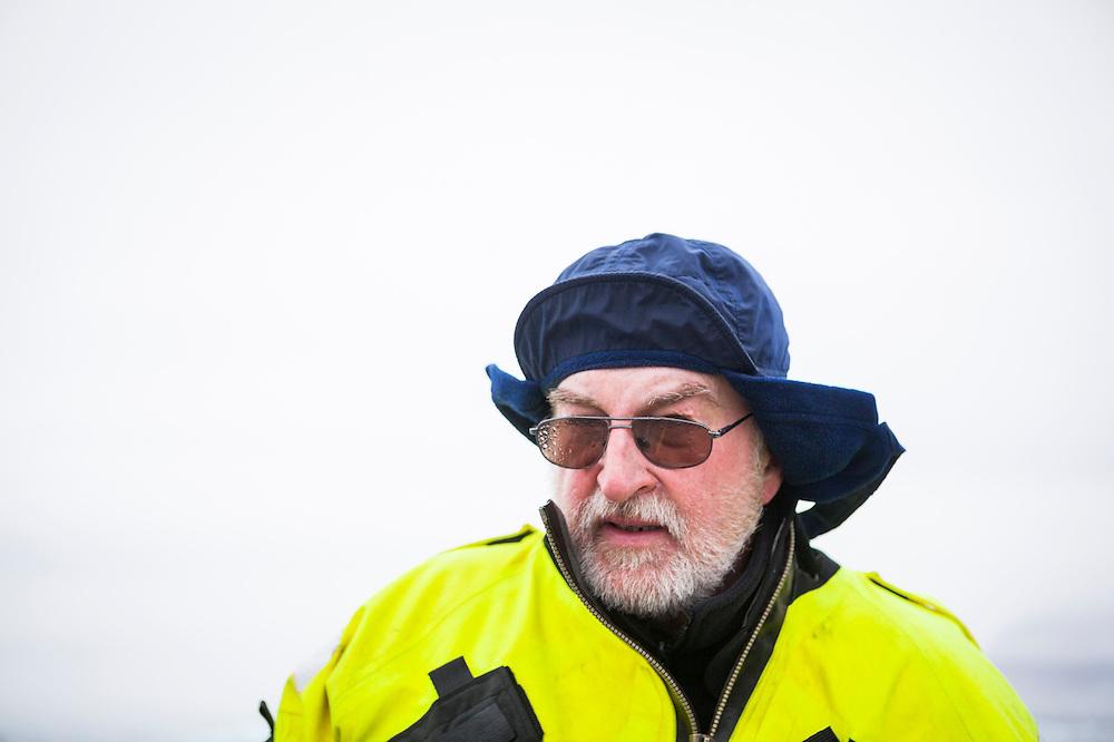 Glaciologist Jacek Jania in the field during a rainstorm in Hornsund, Svalbard.