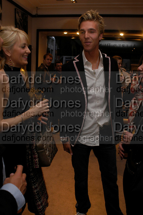 Lady Emily Compton and James Cook. Celebration of Dunhill Motorities, Dunhill, 48 Jermyn St. London. 19 May 2005. ONE TIME USE ONLY - DO NOT ARCHIVE  © Copyright Photograph by Dafydd Jones 66 Stockwell Park Rd. London SW9 0DA Tel 020 7733 0108 www.dafjones.com