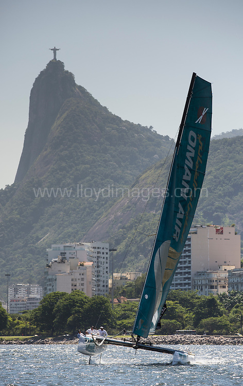 5th December, 2012. Rio de Janeiro, Brazil..Extreme Sailing Series 2012, Act 8..Images of Oman Air, skippered by Morgan Larson (USA), with tactician Will Howden (GBR), mainsail trim Charlie Ogletree (USA), headsail trim Andy Maloney (NZL) and bowman Nasser Al Mashari (OMA)...Credit: Lloyd Images.