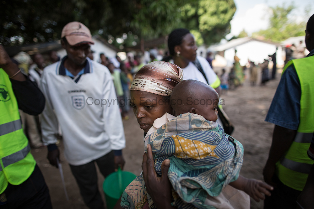 DRC / Burundi Refugees / On May 11th, some 150 Burundian refugees have been relocated from the Luvungi makeshift camp to the UNHCR-run Kavimvira transit<br /> centre in Uvira, DRC's South Kivu Province. About 700 vulnerable Burundian refugees are hosted in Kavimvira transit centre.<br /> <br /> More than 9000 Burundians refugees have crossed into the DRC over the past few weeks. The new<br /> arrivals are being hosted by local families, but the growing numbers are straining<br /> available support. UNHCR is helping some 700 vulnerable refugees at a transit centre<br /> at Kavimvira and in another centre at Sange. Work is ongoing to identify a site<br /> where all the refugees can be moved, and from where they can have access to<br /> facilities such as schools, health centers and with proper security. / UNHCR / F.Scoppa / May 2015