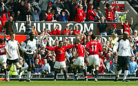 Manchester United's Ruud van Nistelrooy celebrates scoring the second penalty against Liverpool during the Premiership match at Old Trafford, Manchester, Saturday, March 5th, 2003.<br /><br />Pic by David Rawcliffe/Propaganda<br /><br />Any problems call David Rawcliffe +44(0)7973 14 2020 david@propaganda-photo.com http://www.propaganda-photo.com