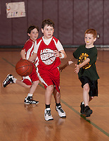 Ryan Dee of Laconia's Lou Athanas team dribbles down court guarded by Gilmanton's Dylan Booth during the Junior Coed Division Championship game during the 19th Annual Francoeur/Babcock Basketball Tournament Sunday morning.  (Karen Bobotas/for the Laconia Daily Sun)