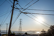 October 9, 2019, the sun lowers over the  San Francisco Bay Area through transformer towers and a PG&E electric substation as residents anticipate a pre-emptive power shutoff to help avoid wildfire.