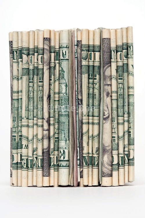 the back of a stack with various dollar bills