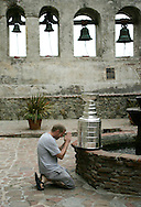 A Los Angeles Kings fan says a prayer for playoff hockey during a stop by the Stanley Cup at the Mission in San Juan Capistrano July 7, 2007.