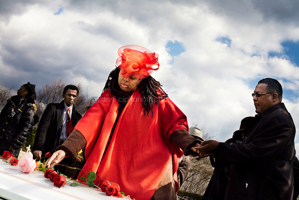 Hartsdale, New York, USA - March 20. Ebeony Harris-Byrd places a rose on the casket of her aunt Bernice McCants, 72 years old, before the burial at the cemetery on March 20, 2008 in Hartsdale, New York, USA.