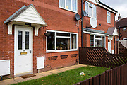A dog sits in the window of a house on a council estate in Leyland, Lancashire.