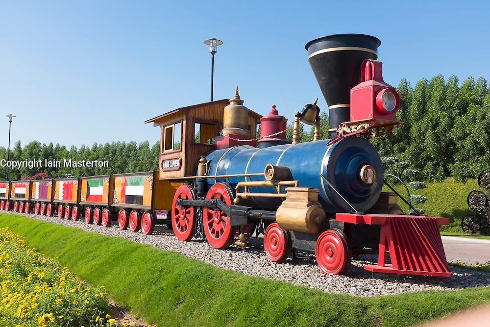 Steam train on display at Miracle Garden the world's biggest flower garden in Dubai United Arab Emirates