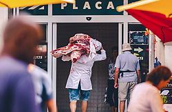 THEMENBILD - ein Händler trägt frisches Fleisch auf dem Stadtmarkt in Rijeka, aufgenommen am 13. August 2019 in Rijeka, Kroatien // a trader carries fresh meat to the meat on the market in Rijeka, Croatia on 2019/08/13. EXPA Pictures © 2019, PhotoCredit: EXPA/Stefanie Oberhauser