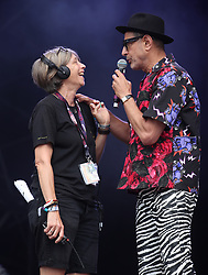 Actor Jeff Goldblum jokes around with a stage technician ahead of his performance with the Mildred Snitzer Orchestra at the West Holts Stage during the fifth day of the Glastonbury Festival at Worthy Farm in Somerset.